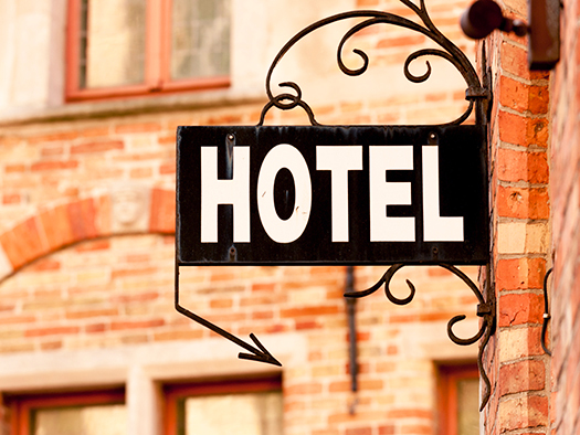 Hotel sign at the entrance of cozy accommodation in European cit